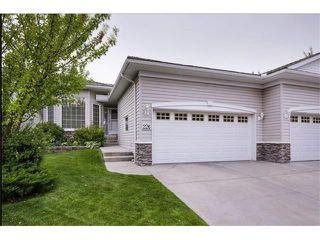 Main Photo: 226 ROCKY RIDGE Villa(s) NW in Calgary: Rocky Ridge House for sale : MLS®# C4078157
