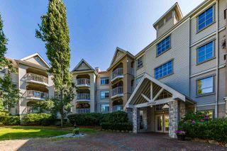 Photo 2: 121 20894 57 Avenue in Langley: Langley City Condo for sale : MLS®# R2302015