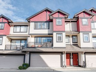 "Photo 1: 19 7168 179 Street in Surrey: Cloverdale BC Townhouse for sale in ""OVATION"" (Cloverdale)  : MLS®# R2311901"