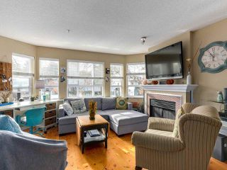 "Photo 2: 252 2565 W BROADWAY in Vancouver: Kitsilano Condo for sale in ""TRAFALGAR MEWS"" (Vancouver West)  : MLS®# R2321224"