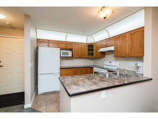 "Photo 3: 215 11605 227 Street in Maple Ridge: East Central Condo for sale in ""Hillcrest"" : MLS®# R2372554"