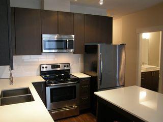 """Photo 16: 204 2351 KELLY AVENUE in """"LA VIA"""": Home for sale : MLS®# R2034370"""