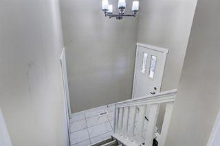 Photo 2: 635 WHITERIDGE Way NE in Calgary: Whitehorn Duplex for sale : MLS®# A1015180