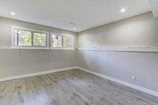 Photo 18: 635 WHITERIDGE Way NE in Calgary: Whitehorn Duplex for sale : MLS®# A1015180