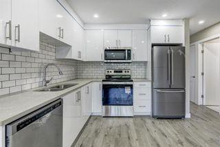 Photo 1: 635 WHITERIDGE Way NE in Calgary: Whitehorn Duplex for sale : MLS®# A1015180