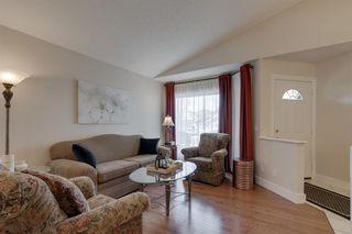 Photo 5: 139 DOUGLASVIEW Bay SE in Calgary: Douglasdale/Glen Detached for sale : MLS®# A1016646