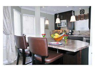 "Photo 2: 316 1215 LANSDOWNE Drive in Coquitlam: Upper Eagle Ridge Townhouse for sale in ""SUNRIDGE ESTATES"" : MLS®# V871918"
