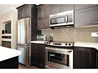 """Photo 5: 60 7090 180TH Street in Surrey: Cloverdale BC Townhouse for sale in """"THE BOARDWALK"""" (Cloverdale)  : MLS®# F1323453"""