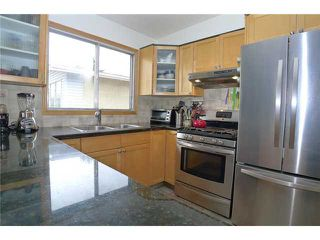 Photo 7: 18 BEAVER DAM Place NE in CALGARY: Thorncliffe Residential Attached for sale (Calgary)  : MLS®# C3611407
