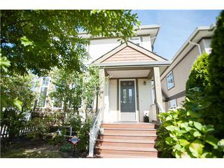"""Photo 1: 5790 149TH Street in Surrey: Sullivan Station House for sale in """"PANORAMA VILLAGE"""" : MLS®# F1444587"""