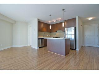 """Photo 2: 444 15850 26 Avenue in Surrey: Grandview Surrey Condo for sale in """"AXIS AT MORGAN CROSSING"""" (South Surrey White Rock)  : MLS®# R2034692"""