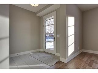 Photo 19: 2116 2 Avenue NW in Calgary: 3 Storey for sale : MLS®# C3541376