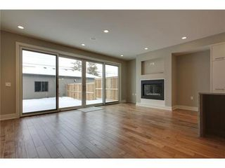Photo 6: 2116 2 Avenue NW in Calgary: 3 Storey for sale : MLS®# C3541376