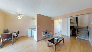 Main Photo: 8A MEADOWLARK Village NW in Edmonton: Zone 22 Townhouse for sale : MLS®# E4110830