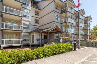 """Photo 1: 302 1203 PEMBERTON Avenue in Squamish: Downtown SQ Condo for sale in """"Eagle Grove"""" : MLS®# R2324945"""