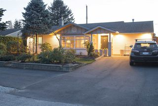 "Photo 2: 1211 SILVERWOOD Crescent in North Vancouver: Norgate House for sale in ""Norgate"" : MLS®# R2355947"