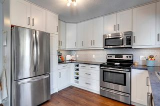 Photo 5: 3735 42 Street SW in Calgary: Glenbrook Semi Detached for sale : MLS®# A1038349