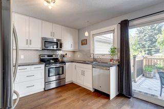 Photo 4: 3735 42 Street SW in Calgary: Glenbrook Semi Detached for sale : MLS®# A1038349