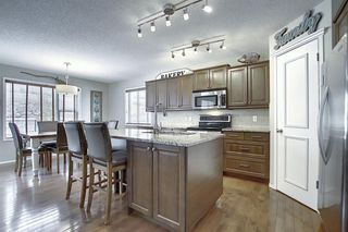 Photo 5: 7720 Springbank Way SW in Calgary: Springbank Hill Detached for sale : MLS®# A1043522