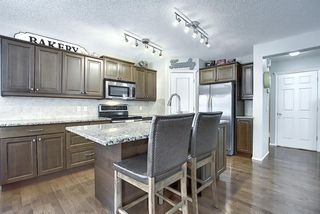Photo 6: 7720 Springbank Way SW in Calgary: Springbank Hill Detached for sale : MLS®# A1043522