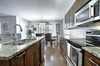 Photo 7: 7720 Springbank Way SW in Calgary: Springbank Hill Detached for sale : MLS®# A1043522