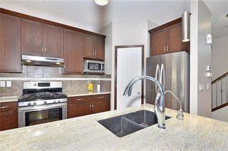 Photo 5: 739 NEW BRIGHTON Drive SE in Calgary: New Brighton House for sale : MLS®# C4175225