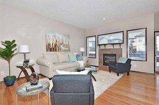 Photo 2: 739 NEW BRIGHTON Drive SE in Calgary: New Brighton House for sale : MLS®# C4175225