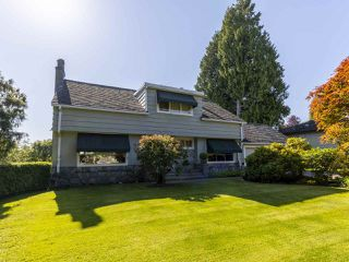 """Photo 1: 6145 COLLINGWOOD Street in Vancouver: Kerrisdale House for sale in """"SOUTHLANDS"""" (Vancouver West)  : MLS®# R2376095"""
