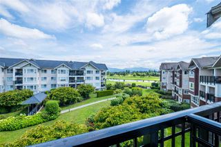 "Photo 4: 422 19677 MEADOW GARDENS Way in Pitt Meadows: North Meadows PI Condo for sale in ""The Fairways"" : MLS®# R2469723"