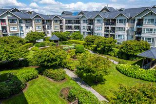 "Photo 2: 422 19677 MEADOW GARDENS Way in Pitt Meadows: North Meadows PI Condo for sale in ""The Fairways"" : MLS®# R2469723"
