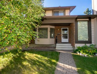 Photo 3: 79 COACHWAY Road SW in Calgary: Coach Hill Semi Detached for sale : MLS®# A1032445