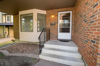 Photo 4: 79 COACHWAY Road SW in Calgary: Coach Hill Semi Detached for sale : MLS®# A1032445