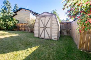 Photo 30: 79 COACHWAY Road SW in Calgary: Coach Hill Semi Detached for sale : MLS®# A1032445