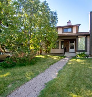 Photo 2: 79 COACHWAY Road SW in Calgary: Coach Hill Semi Detached for sale : MLS®# A1032445