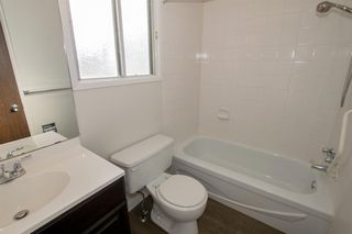 Photo 22: 79 COACHWAY Road SW in Calgary: Coach Hill Semi Detached for sale : MLS®# A1032445