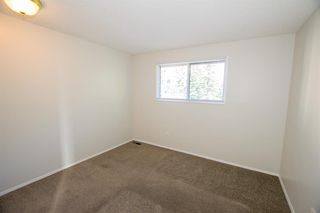 Photo 20: 79 COACHWAY Road SW in Calgary: Coach Hill Semi Detached for sale : MLS®# A1032445