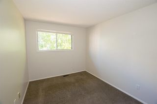 Photo 21: 79 COACHWAY Road SW in Calgary: Coach Hill Semi Detached for sale : MLS®# A1032445