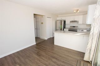 Photo 15: 79 COACHWAY Road SW in Calgary: Coach Hill Semi Detached for sale : MLS®# A1032445