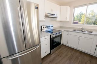 Photo 9: 79 COACHWAY Road SW in Calgary: Coach Hill Semi Detached for sale : MLS®# A1032445