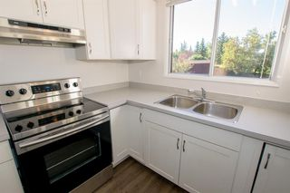 Photo 10: 79 COACHWAY Road SW in Calgary: Coach Hill Semi Detached for sale : MLS®# A1032445