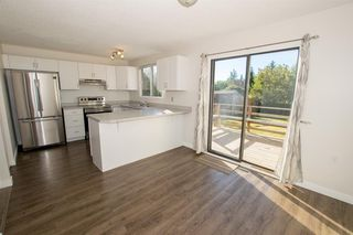 Photo 14: 79 COACHWAY Road SW in Calgary: Coach Hill Semi Detached for sale : MLS®# A1032445