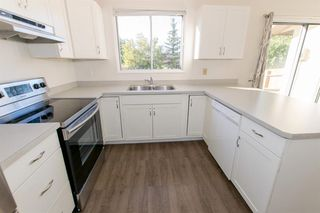 Photo 12: 79 COACHWAY Road SW in Calgary: Coach Hill Semi Detached for sale : MLS®# A1032445