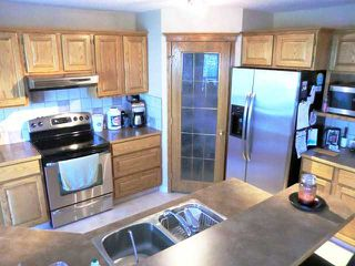 Photo 8: 137 BOW RIDGE Crescent: Cochrane Residential Detached Single Family for sale : MLS®# C3481163