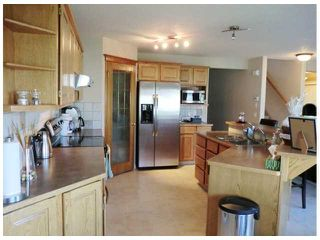 Photo 7: 137 BOW RIDGE Crescent: Cochrane Residential Detached Single Family for sale : MLS®# C3481163