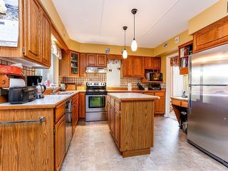 Photo 7: 5916 123 Street in Surrey: Panorama Ridge House for sale : MLS®# F1409816