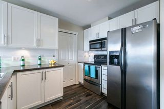 "Photo 3: 201 3880 CHATHAM Street in Richmond: Steveston Village Condo for sale in ""Steveston Village"" : MLS®# R2039827"