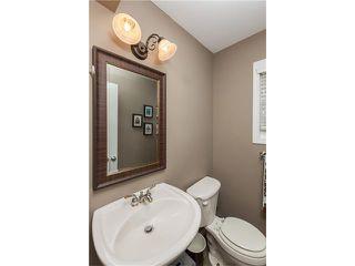 Photo 9: 1134 LAKE CHRISTINA Way SE in Calgary: Lake Bonavista House for sale : MLS®# C4051851