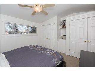 Photo 14: 1134 LAKE CHRISTINA Way SE in Calgary: Lake Bonavista House for sale : MLS®# C4051851