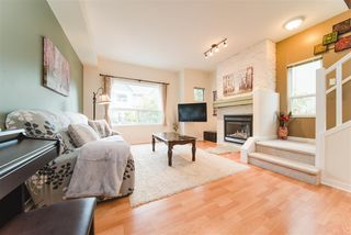 "Photo 1: 51 15065 58 Avenue in Surrey: Sullivan Station Townhouse for sale in ""SPRINGHILL"" : MLS®# R2411473"