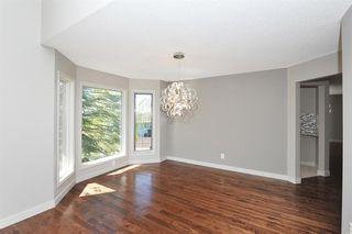 Photo 6: 315 Hawkdale Bay NW in Calgary: Hawkwood Detached for sale : MLS®# A1057091